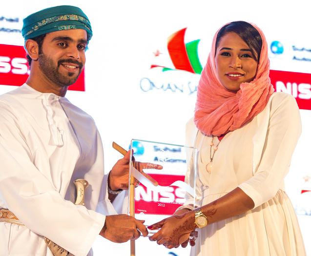 Hussain & Intisar accepting award